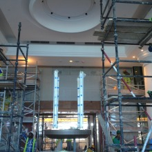 Placing the brass supports for the top of the clock at the hotel in Dubai