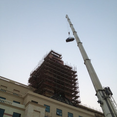 Setting the clocks on top of a clock tower at a university in Manama Bahrain