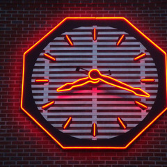 Fire station clock outside Louisville, KY lit up at night with Red LED lights and a custom aluminum clock 8 foot diameter