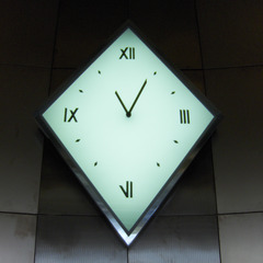 Custom glass and stainless steel clock in the lobby of the Galleria in Columbus OH