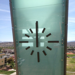 Illuminated clock numbers set on a glass wall Dixie State University St. George UT
