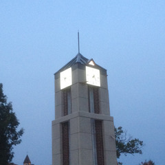 Wesleyan college clock tower at night, Rochester NY