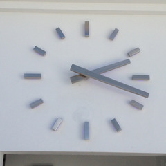 Brushed Stainless Steel clock numbers above a yacht club pool, West Palm Beach FL
