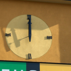 Moderns clock numbers mounted on stucco, Santa Cruz CA