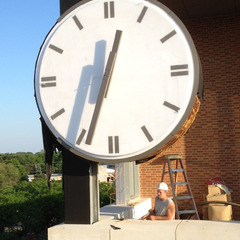 Installation of a 10 foot clock at the Bloomington Normal IL trainstation and town hall
