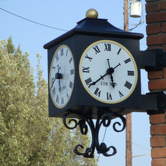 Historic Redlands CA custom street clock with ornamental ironwork