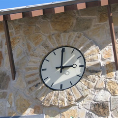 Ivory acrylic clock face with custom clock hands for a pool outside Dallas TX