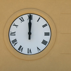 Roman numeral wall clock on a hospital near Houston TX
