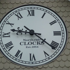 Retail center wall clock with custom logo, Manchester TN