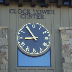 Raised gold leaf roman numerals on a brown alumium clock in Heber City, UT outside Salt Lake City