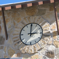 Ivory Acrylic clock face with custom clock hands for an pool outside of Dallas, TX