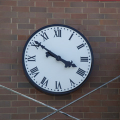 Retail center clock on brick wall, Long Island NY