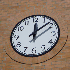Clock with brick soldier course