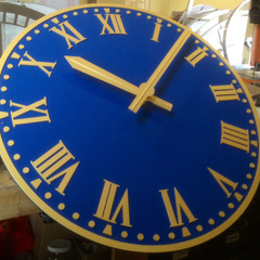 Raised aluminum gold leaf numbers on a blue clock, NYC Hotel clock