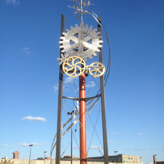 Rotary club moving sculpture with large gears