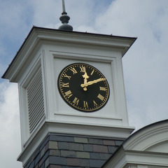 Raised gold leaf numbers on a cupola clock, private residence, Greenwich CT