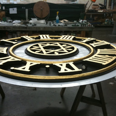 Hand laid gold leafing on restored courthouse clock tower