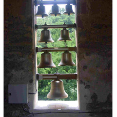 Bronze bells in a church window